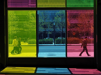 "Walking in the colours: picture of peoples walking on the sidewalk outside the ""Palais des congrès"" in Montréal. / Photo de rue prise de l'interieure du Palais des congres a Montreal."
