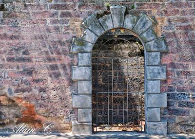 Iron door in the pink  rock